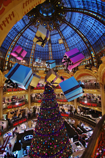 1. An elaborate Christmas tree and dangling gifts add a festive spirit to this mall in paris