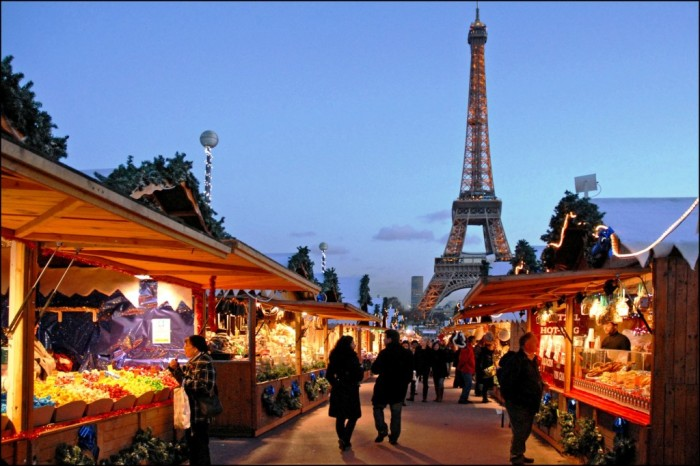 7. Vendors set up beautiful and festive displays of their goods near the Eiffel Tower