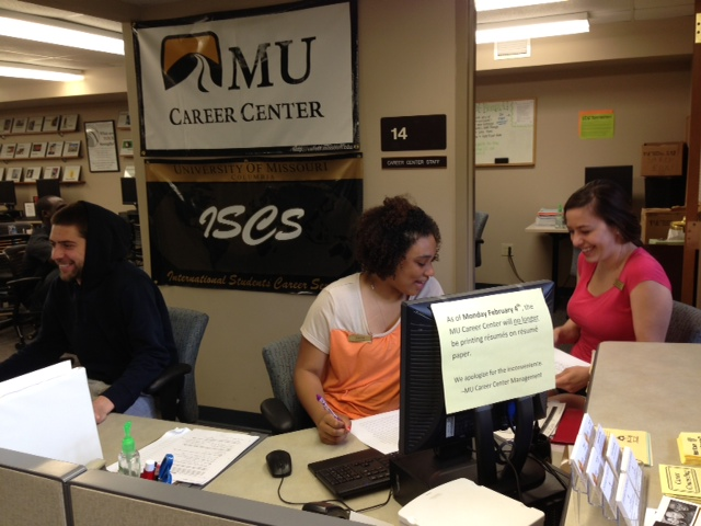 Student workers and assistants managing the front desk