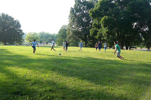 Students playing soccer at Stephens Lake during Picnic in the Park