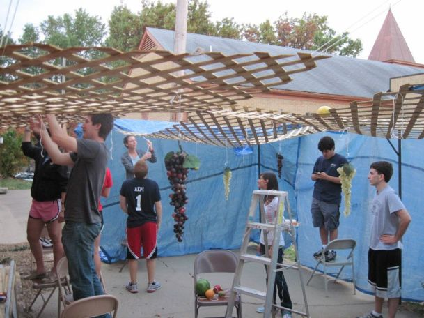 Students building a Sukkah
