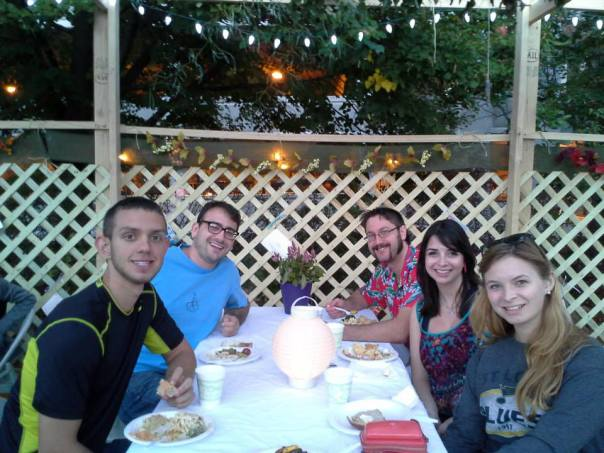 Enjoying dinner under the Sukkot