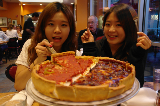 Minjeong and her friend enjoy Chicago's famous deep dish pizza!