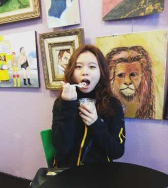 Minjeong enjoys ice cream from one of Columbia's local ice cream shops, Sparky's